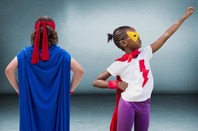 Two kids in superhero costumes/disguises.