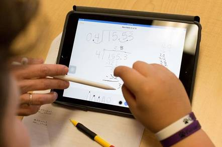 Pupil doing long division on an iPad