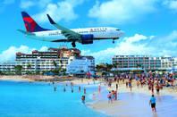 Delta flight over a beach