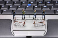 Miniature SWAT team guarding laptop keyboard