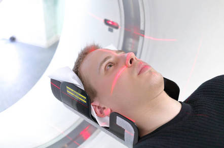 Close-up of man undergoing CT scan