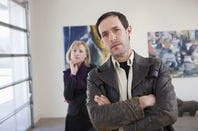two people 'appreciating' art in a gallery... look a bit pretentious doing so.