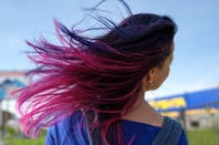 Woman with fuchsia, purple, pink hair