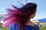 Woman with fuchsia, purple, pink hair