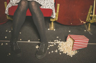 Woman accidentally kicks over bucket of popcorn in cinema