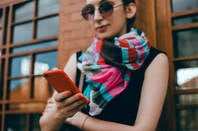 hipster girl in scarf on phone