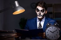 man dressed as zombie doing accounts/audit
