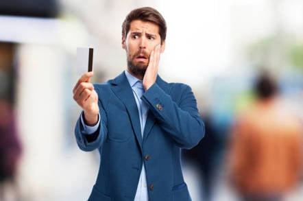 man looks worried with credit card
