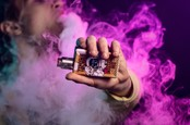 Person holding vape box