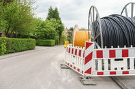 Fiber optic cable for fast internet - laying cable in residential area