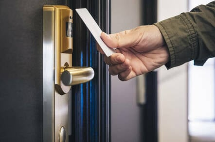 Man opens hotel room with key card