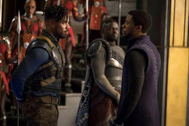 Marvel Studios' BLACK PANTHER..L to R: Erik Killmonger (Michael B. Jordan) and T'Challa/Black Panther (Chadwick Boseman), b/g W'Kabi (Daniel Kaluuya)..Photo: Matt Kennedy..©Marvel Studios 2018