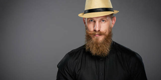 Bearded hipster gent wearing straw fedora