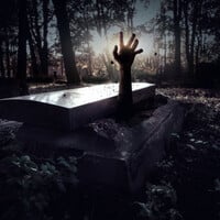 Undead hand reaching out of grave