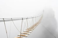 Shutterstock Rope Bridge Mist Man Walking
