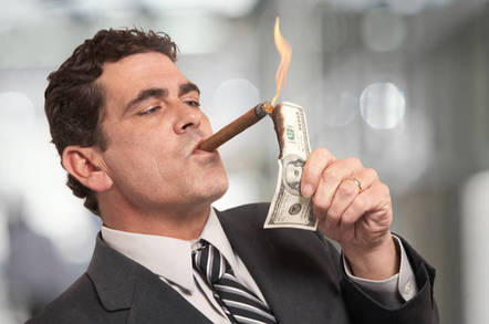Man lights his cigar with a $100 bill