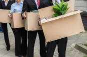 employees leave with cardboard boxes
