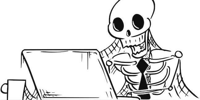 Skeleton at computer