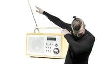man dabs in front of DAB radio