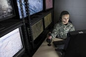 military staffer looks at monitor (drones)