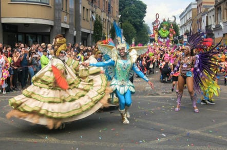 Parade of dancers in costume at  London's Notting Hill carnival.