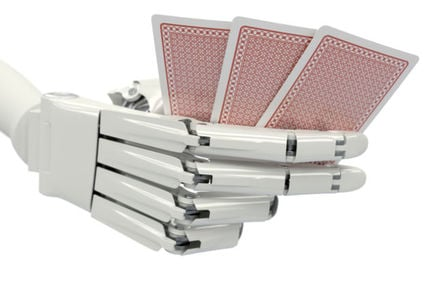 Robot hand holding cards
