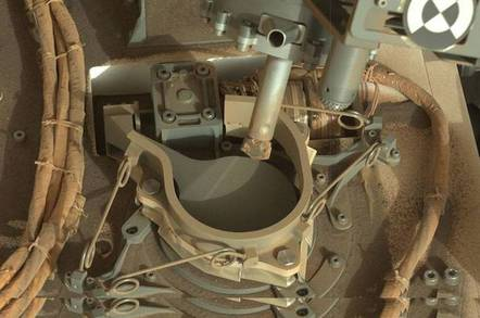 Curiosity's drill over the laboratory intake