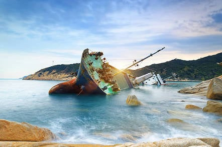 Wrecked cargo ship abandoned on sea bay
