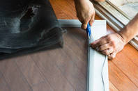 A screen door being repaired