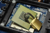 An unlocked padlock on a chip, hint hint