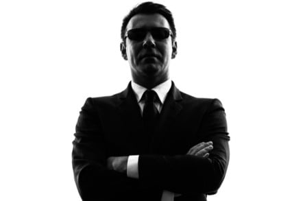 Secret service agent in silhouette on white background