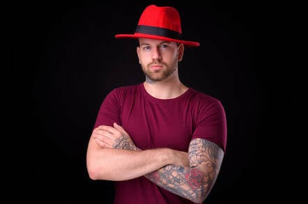 A dude wearing a red hat