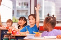 Kid raising hand in school