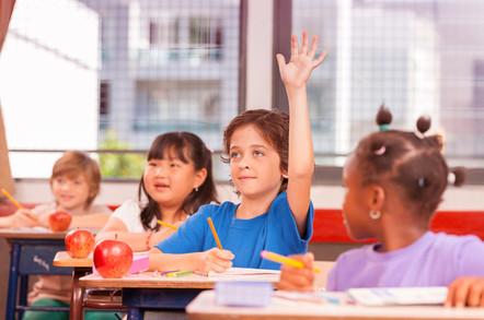 Kid raising hand in school