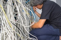 Sysadmin clutching his head
