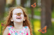 A child with a butterfly, from shutterstock