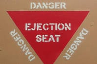Ejection seat warning label