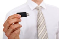 Businessman holding USB stick