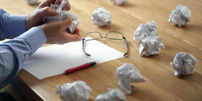 Business Plans gone awry, crumbled paper