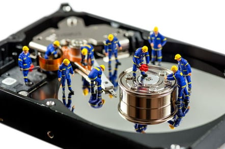 miniature workers  on a hard disk