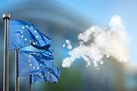 EU flags against cloudy backdrop