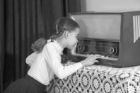 50s schoolgirl listens to vintage radio
