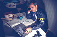 FBI agent on a phone