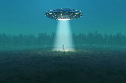 A flying saucer in a field