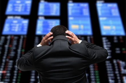 Stock market trader worries looks at board