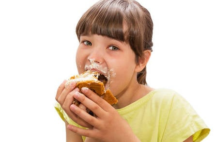A kid eating a cake