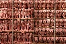 shelf filled with many sizes of pink panther dolls