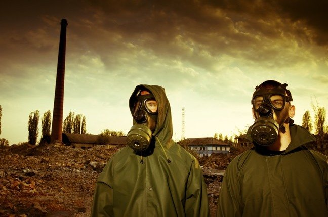 People wearing biohazard suits after nuclear explosion