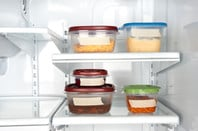 containers full of food in fridge