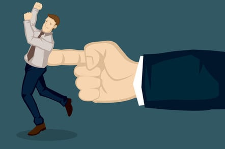A giant hand pushing at business executive